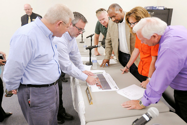 Don Knight   The Herald Bulletin<br /> Architect Michael Garringer shows renderings of the remodeled Wigwam complex to Mayor Kevin Smith, ACS Superintendent Terry Thompson, board members Dr. Scott Green, Danny McGhee and Stephanie Moran. The Anderson Redevelopment Commission and Anderson Community Schools board voted to transfer the Wigwam complex to BWI and Pinebrook Properties LLC on Thursday.