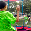 John P. Cleary | The Herald Bulletin<br /> Anthony Taliaferro, 8, yells at his grandmother Pam Mock as she tries to knock him off his seat and into the dunk tank Saturday during the City Wide Community Day at Dickmann Town Square.