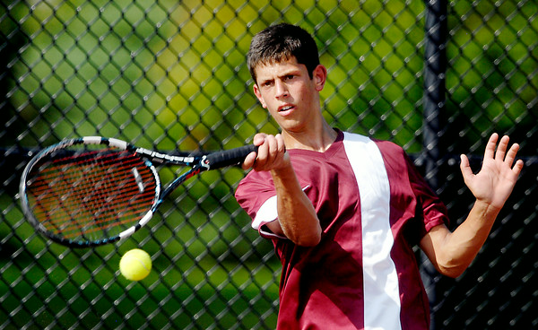 John P. Cleary | The Herald Bulletin<br /> Josh Deutsch, of Alexandria High School,  returns a forehand shot during his #1 singles match Monday against Anderson High School's Joe Moran.<br /> To view or buy this photo and other Herald Bulletin photos, visit<br /> photos.heraldbulletin.com.