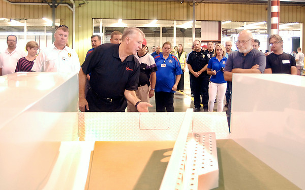 John P. Cleary | The Herald Bulletin<br /> Rick Manasek, president of Warner Bodies, shows visitors one of the company's bodies that is in the final assembly area as he led one of the group tours through the 240,000 square-foot facility Wednesday. To view or buy this photo and other Herald Bulletin photos, visit<br /> photos.heraldbulletin.com.