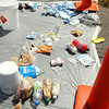 John P. Cleary | The Herald Bulletin<br /> This is some of the evidence State Police had collected after executing a search warrant at a home in the 2600 block of Brown Street in Anderson Monday morning.  They spread the items out in the street along the curb as they went about their investigation.
