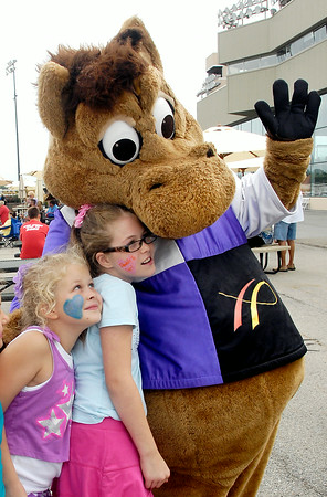 John P. Cleary | The Herald Bulletin<br /> Victoria Chambers, 8, and Asia Chambers, 9, get a hug from Hoosier Buddy,  Hoosier Park's racing mascot, Saturday afternoon during 'Family Fun Days' that started Saturday and will run each weekend throughout the rest of the harness racing meet. To view or buy this photo and other Herald Bulletin photos, visit<br /> photos.heraldbulletin.com.