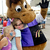 John P. Cleary   The Herald Bulletin<br /> Victoria Chambers, 8, and Asia Chambers, 9, get a hug from Hoosier Buddy,  Hoosier Park's racing mascot, Saturday afternoon during 'Family Fun Days' that started Saturday and will run each weekend throughout the rest of the harness racing meet. To view or buy this photo and other Herald Bulletin photos, visit<br /> photos.heraldbulletin.com.