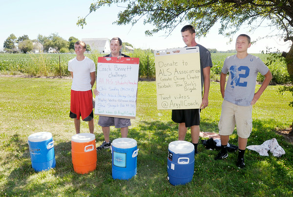 Don Knight | The Herald Bulletin<br /> From left, Jordan Crune, coach Brian Bennett, Tanner Wise and Jacob Price take the ALS Ice Bucket Challenge at Madison-Grant on Friday.  To view or buy this photo and other Herald Bulletin photos, visit photos.heraldbulletin.com.