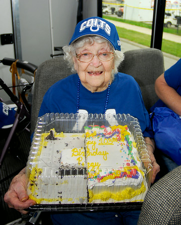 "John P. Cleary | The Herald Bulletin<br /> Peggy Dollens celebrated her 103rd birthday Tuesday out at Colts Camp where they gave her a birthday cake, football, and hat.   The team is also going to make Peggy their ""12th Man"" for their home game against Cincinnati October 19th and bring her out on the field and introduce her.  Dollens is a resident of Bethany Pointe Health Campus who takes a group of residents each year to Colts Camp."