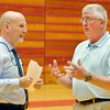 John P. Cleary | The Herald Bulletin<br /> Greg Winkler, executive director for the Anderson Economic Development Department, talks with Lewis Kinkead M.D., a partner in the group wanting to convert the Wigwam into senior housing, on the gym floor as a group of local officials went through the facility Wednesday morning.