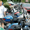 John P. Cleary | The Herald Bulletin<br /> Mike Pierce of Anderson looks over the motorcycles parked along Meridian Street that took part in the event ride for the City Wide Community Day Saturday.