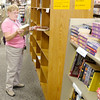 Don Knight | The Herald Bulletin<br /> Shirley Owen from Daleville looks through the selection at The Book Nook in the Mounds Mall. Books are $2 with proceeds used to provide free literacy services to local adults and children. To view or buy this photo and other Herald Bulletin photos, visit photos.heraldbulletin.com.