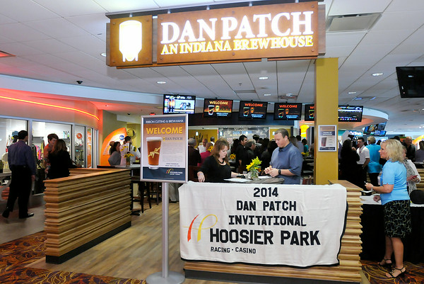 Don Knight   The Herald Bulletin<br /> Hoosier Park invited business and community leaders to their Dan Patch Brewhouse for a ribbon cutting and sampling on Thursday. The Brewhouse was the last part of Hoosier Parks' remodeling of the terrace. To view or buy this photo and other Herald Bulletin photos, visit photos.heraldbulletin.com.