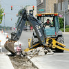 Don Knight | The Herald Bulletin<br /> Work is underway on the sidewalks and lighting on Jackson Street in Anderson. The project includes sidewalk repair and replacement with a row of bricks along the street, decorative lighting, green space and tree plantings. The crosswalks at the street intersections will be brought into compliance with Americans with Disabilities Act guidelines.
