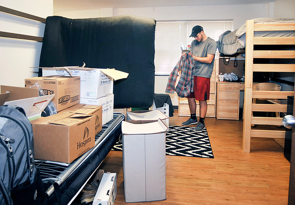 John P. Cleary   The Herald Bulletin<br /> Incoming Anderson University freshman Grant Hammons, from Pendleton, starts to unpack and hang up clothes in his new home away from home, Smith Hall at AU. Thursday was move-in day for 475 freshman and transfer students.