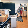John P. Cleary | The Herald Bulletin<br /> Incoming Anderson University freshman Grant Hammons, from Pendleton, starts to unpack and hang up clothes in his new home away from home, Smith Hall at AU. Thursday was move-in day for 475 freshman and transfer students.