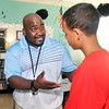 John P. Cleary | The Herald Bulletin<br /> Kojak Fuller is a life coach through the COMPASS program at ACS.<br /> Here Kojak has a talk with 8th grader Quintin Blount at the COMPASS School.