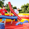 Don Knight | The Herald Bulletin<br /> From left, Ben Webb and Markus Williams joust as Liberty Christian held their Back to School Bash Saturday at their Hillcrest campus.