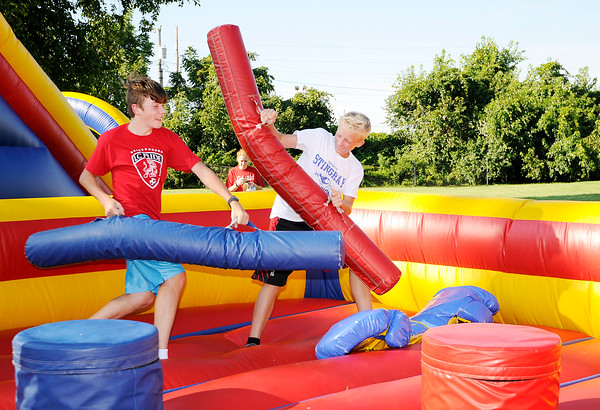 Don Knight | The Herald Bulletin From left, Ben Webb and Markus Williams joust as Liberty Christian held their Back to School Bash Saturday at their Hillcrest campus.