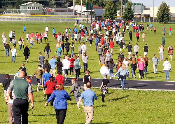 John P. Cleary   The Herald Bulletin<br /> Pendleton Heights Middle School Students and staff  run to their pre-determined rendevouz location during the schools active threat drill Tuesday morning.