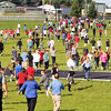 John P. Cleary | The Herald Bulletin<br /> Pendleton Heights Middle School Students and staff  run to their pre-determined rendevouz location during the schools active threat drill Tuesday morning.