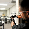 John P. Cleary | The Herald Bulletin<br /> Bill Ingles, Chief of Chesterfield PD, peers around the corner into a room to check for any suspects as he goes through tactical training this week at Ivy Tech at 104 W. 53rd Street.