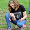John P. Cleary | The Herald Bulletin<br /> Highland Middle School eighth grader Amber Webb checks some seeds as students in the new agriculture class work out in the class garden.