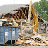 Don Knight | The Herald Bulletin<br /> A crew from Gerry's Construction started demolishing the former Brown's Bowling Center on Broadway in Anderson on Thursday.