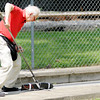 Don Knight | The Herald Bulletin<br /> Paul Strobel gives his tether car a push while holding a battery that heats a glow plug in the engine during American Miniature Racing Car Association practice at Jackson Park in Anderson. Strobel traveled from Zurich Switzerland to compete in Anderson.