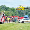 John P. Cleary | The Herald Bulletin<br /> The first of two medical helicopters lifts off from the scene of a late-morning three vehicle fatal crash on Indiana 37 south of Elwood near Indiana 128.