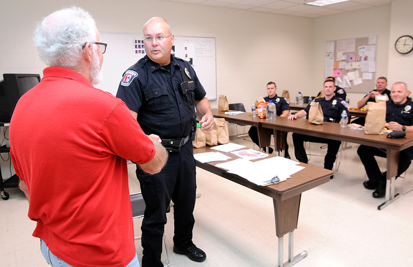 Don Knight | The Herald Bulletin<br /> APD's Sgt. Steve Denny thanks East Side House of Prayer Pastor Jimmy Boicourt after a group from the church delivered lunches to APD officers during their roll call on Saturday as a show of support for the police.