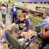 John P. Cleary | The Herald Bulletin<br /> Operation Love volunteer Becki Salatin, center, assists client Treneisha Coles, right, as they go through the food pantry this past Wednesday.