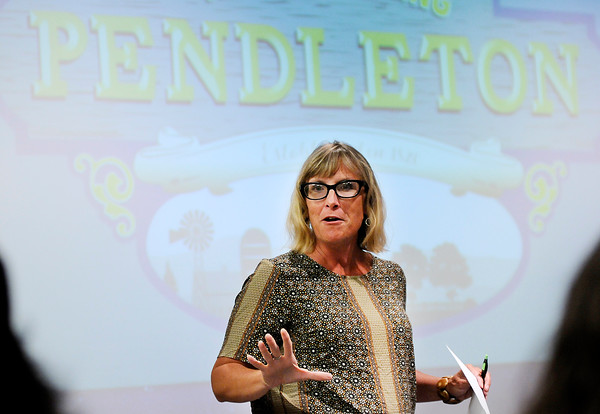 """Don Knight   The Herald Bulletin<br /> Michelle Kinsey talks to Pendleton residents about WIPB's """"Now Entering..."""" series at the Pendleton Library on Wednesday. The next installment in the series will focus on Pendleton."""