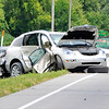 John P. Cleary | The Herald Bulletin<br /> A Madison County Sheriff Department investigator takes photographs of the scene of a late-morning three vehicle fatal crash on Indiana 37 south of Elwood near Indiana 128. One person died in the accident and four others were sent to area hospitals, two by medical helicopters.