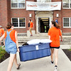 John P. Cleary | The Herald Bulletin<br /> AU student volunteers, junior Nancy Dalton, 21, and sophomore Kennedy Sade, 19, carry a large container into Smith Hall as they help incoming freshmen move in to their new home on campus Thursday.
