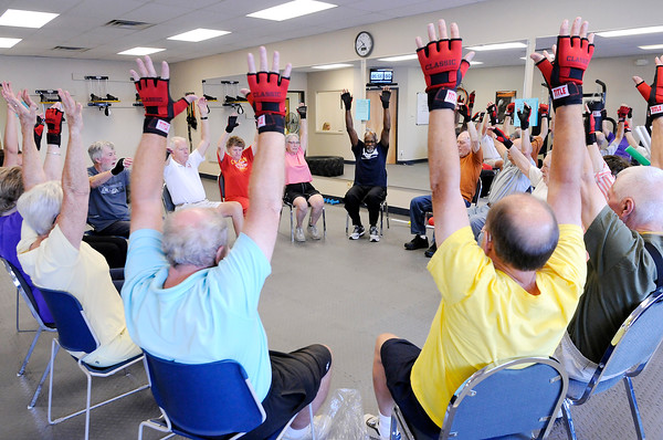 Don Knight | The Herald Bulletin<br /> Sam Watkins, center, leads a group through a Rock Steady Boxing workout on Friday. Community Hospital Anderson launched a Rock Steady program for Parkinson's patients.