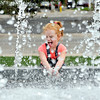 John P. Cleary | The Herald Bulletin<br /> Makenna Nunemaker, 4, has fun with the water spray from the fountain in Sesquicentennial Square at 14th & Main Streets Tuesday as she and her mother, Jeri Keesling, stopped at the park after being at the Anderson Public Library. The family lives in Markleville.