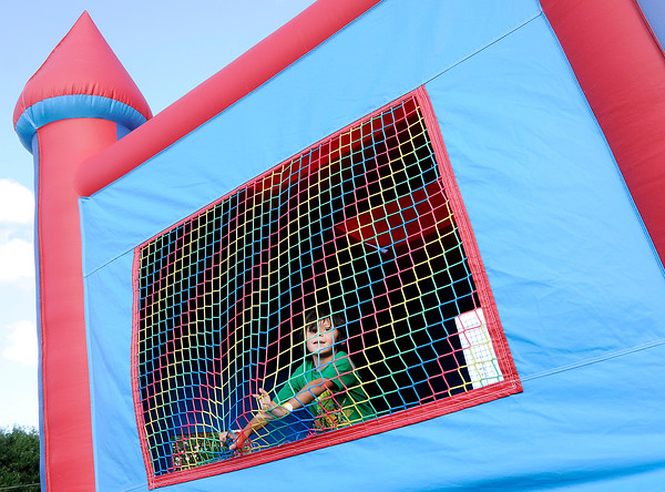 Don Knight | The Herald Bulletin<br /> Jose Leal, 7, jumps in a bounce house during the Madison County Community Health Center Backyard BBQ on Friday. The event was part of National Health Center Week.