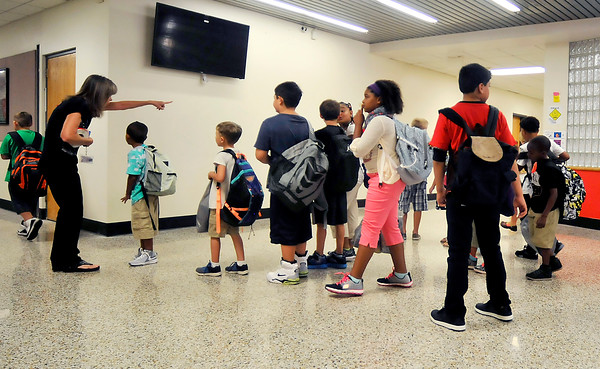 John P. Cleary | The Herald Bulletin<br /> A 10th Street Elementary School staff member directs students where to go as they find their way around on the first day of classes for ACS.