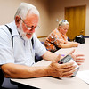 Don Knight | The Herald Bulletin<br /> John Crawford prays during a nondenominational bible study that meets every Tuesday at the Anderson Public Library from 9:15-10:15 a.m. and 5:30-6:30 p.m. Crawford launched the nondenominational bible study this week