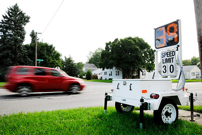 Don Knight | The Herald Bulletin A radar trailer reminds motorists of the 30 mile an hour speed limit on 38th Street in the Meadowbrook neighborhood.
