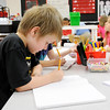 Don Knight | The Herald Bulletin<br /> Owen Caldwell illustrates his story during a lesson in Katie Brandon's class at the Killbuck Kindergarten Extension