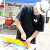 Don Knight | The Herald Bulletin<br /> Joe Morris prepares his car for a practice run on the tether car track at Jackson Park in Anderson. Eight different classes will be competing during Nationals this week.