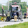 John P. Cleary | The Herald Bulletin<br /> One of the accident victims of a three vehicle fatal crash on Indiana 37 south of Elwood is loaded into a medical helicopter to be airlifted to a Indianapolis hospital.