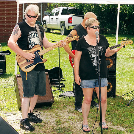Mark Maynard   for The Herald Bulletin<br /> Local musician Mike Gill and his wife, vocalist Cindi, perform during the All Star Jam Fundraiser for the benefit of injured friend and fellow guitar player Dan Daugherty.