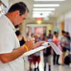 John P. Cleary | The Herald Bulletin<br /> 10th Street Elementary School 5th grade teacher Ryan Scott checks his class list as he waits for students to report to his room on the first day of school.
