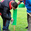 John P. Cleary | The Herald Bulletin<br /> Highland Middle School new agriculture class teacher Andy McCammon helps a student put up a sign in their class garden.