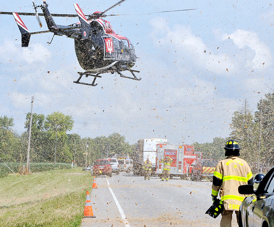 John P. Cleary   The Herald Bulletin<br /> A medical helicopter kicks up debris as it lands at the scene of a three vehicle fatal crash on Indiana 37 south of Elwood near Indiana 128 late Tuesday morning.