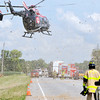 John P. Cleary | The Herald Bulletin<br /> A medical helicopter kicks up debris as it lands at the scene of a three vehicle fatal crash on Indiana 37 south of Elwood near Indiana 128 late Tuesday morning.