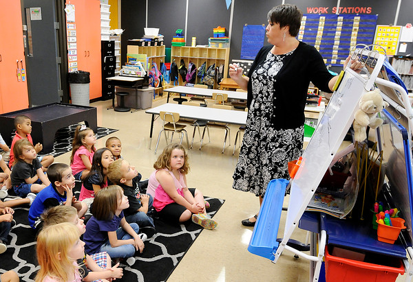 Don Knight   The Herald Bulletin<br /> Katie Brandon goes over a writing lesson with her students at the Killbuck Kindergarten Extension on Wednesday.