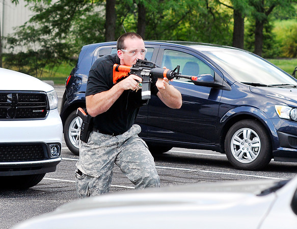 John P. Cleary   The Herald Bulletin<br /> Adam Stephenson, of the Madison County Sheriff Department, goes through training on tactical procedures to approach a building with a active shooter inside. The week-long training sessions are being held at Ivy Tech Community College at 104 W. 53rd St., Anderson.