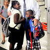 John P. Cleary | The Herald Bulletin<br /> First year principal David Suchocki greets students as they arrive to 10th Street Elementary School on the first day of classes for ACS.