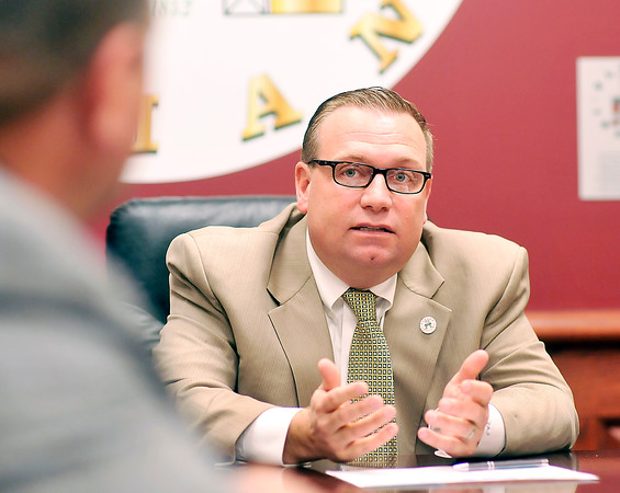 John P. Cleary   The Herald Bulletin<br /> Elwood Mayor Todd Jones talks to Police Chief Jason Brizendine during a recent meeting.