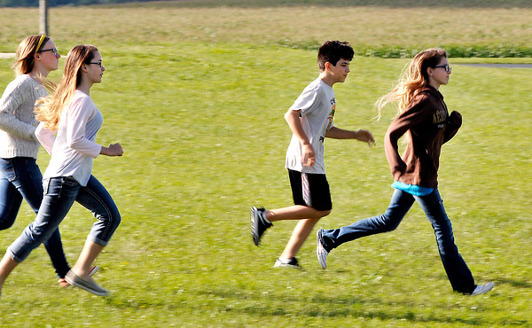 John P. Cleary | The Herald Bulletin<br /> Pendleton Heights Middle School Students run out of the school and to their pre-determined rendevouz location during a active threat drill.